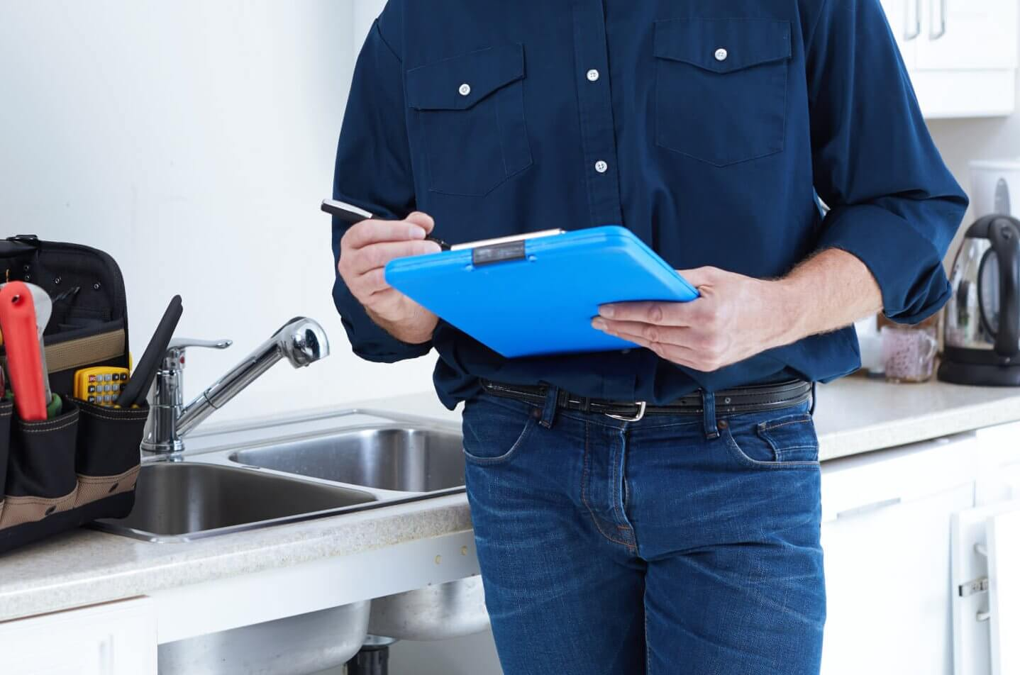 Plumber hands with clipboard image total inspections